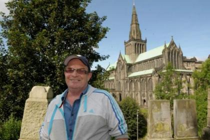Philip 'Dumbleflip' Frey, who has carried the Queen's Baton twice, gives tours around Glasgow Cathedral and the Necropolis