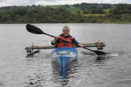 Angie Malone, below centre, tries out a kayak, above, then joins Jackie Maceira, of Scotland Disability Equality Forum, left, and Renfrewshire Access chairman Stephen Cruickshank, right