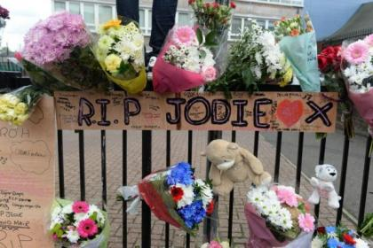 Tributes to Jodie Muir outside her school, Eastbank Academy, in Shettleston