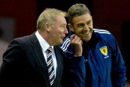 Are you keeping count ... Ally McCoist with fourth official Greg Aitken as Rangers cruise past Clyde