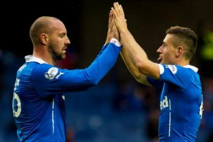 Fraser Aird is congratulated by team-mate Kris Boyd after scoring in Rangers' 8-1 hammering of Clyde