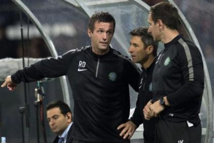 Ronny Deila (left) watches the game from the dug-out with John Collins and John Kennedy