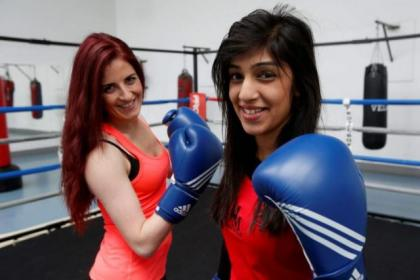 Scottish featherweight champion Farah Jamil and Pauline MacDonald of Bellahouston Amateur Boxing Club have started a      Tuesday night training session for women. Picture: Martin Shields