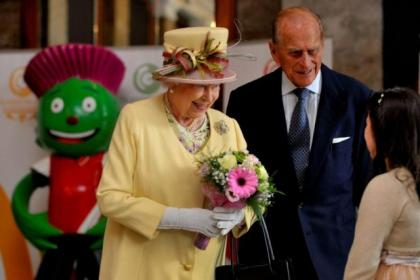 Clyde, seen here 'photobombing' the Queen and Prince Philip, will have a permanent home at the city's Sick Kids' Hospital