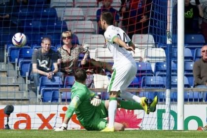 Celtic keeper Lukasz Zaluska looks on as a deflection off Eoghan O'Connell gives Inverness Caley Thistle their winning goal