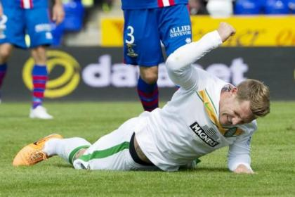 Celtic's Kris Commons pounds the ground in frustration after missing a good goalscoring opportunity