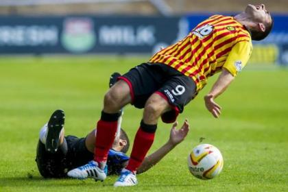 Partick Thistle's Kris Doolan is caught by a sliding tackle from Hamilton Accies' Jesus Garcia Tena
