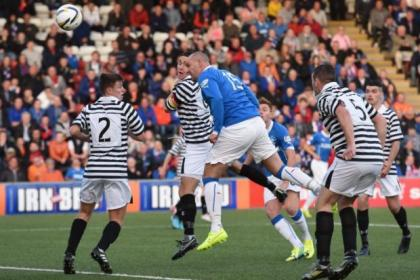 Kris Boyd powers in a header to open the scoring against Queen's Park at the Excelsior Stadium