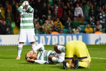 Dejection for Celtic pair Kris Commons, left, and Virgil van Dijk after the Dutchman had a late effort saved by Maribor keeper Jasmin Handanovic