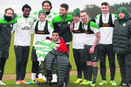 Neil Lennon and his Celtic squad welcomed 21-year-old Sohail Rehman, the first wheelchair-bound, fully-qualified football coach in the world, to Lennoxtown on Friday. Picture: Steve Welsh