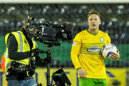 Picture this ... hat-trick hero Kris Commons snapped up the match ball