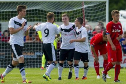 Brora celebrate after taking the lead in 1-1 draw with Rangers