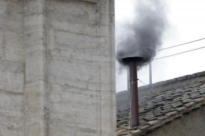 Black smoke has billowed from the chimney of the Sistine Chapel