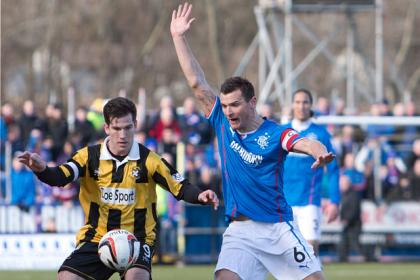 Rangers' Lee McCulloch and East Fife's Liam Buchanan battle for the ball