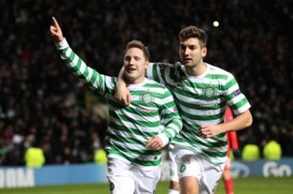 Kris Commons celebrates his goal with Charlie Mulgrew